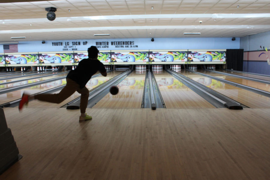 Senior Josh Singh rolls the ball down the lane at a bowling tournament on Monday, August 27 at the Oviedo Lanes.Lake Mary, Lyman, and Oviedo High School were among the teams there.