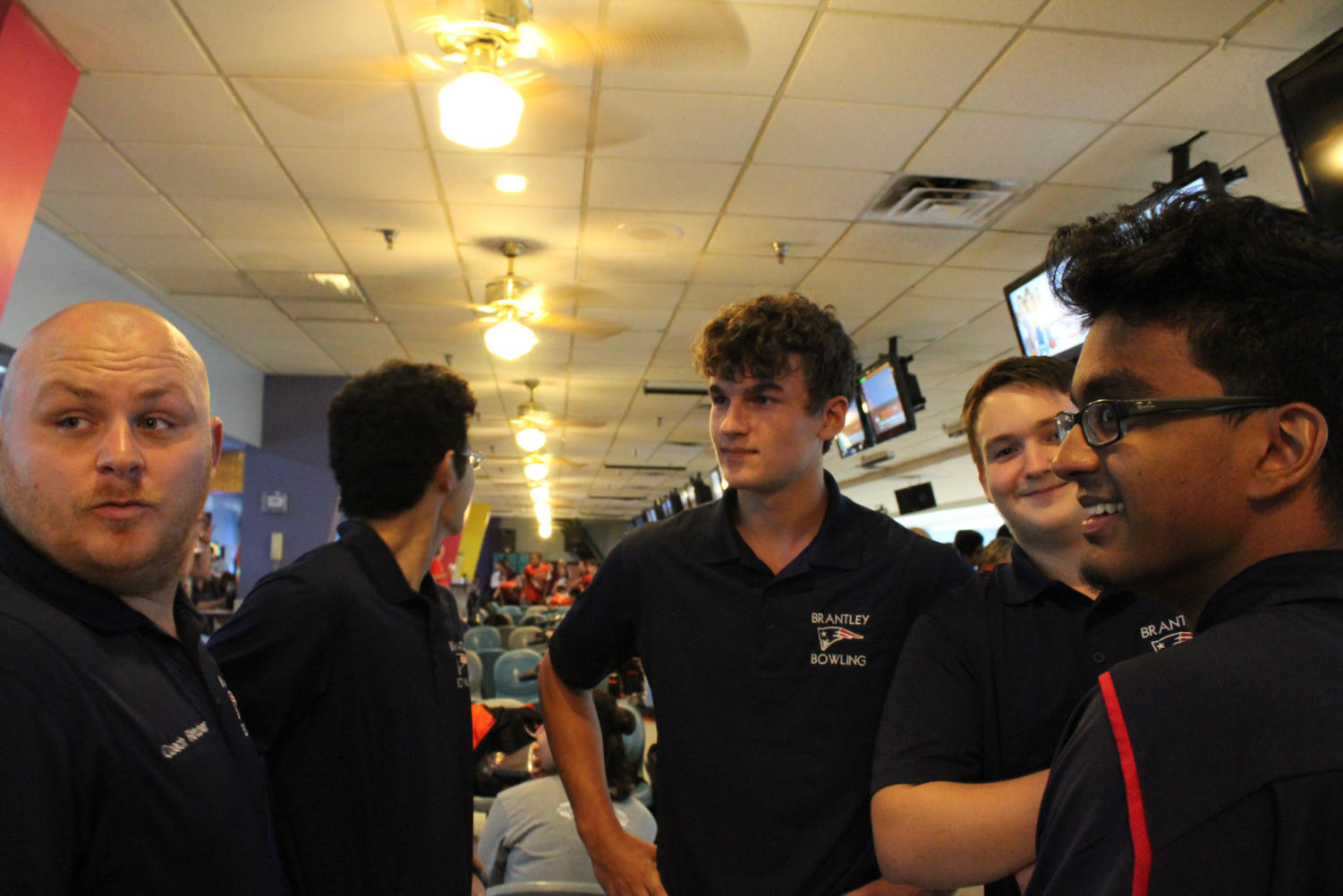 The+boys+bowling+team+and+Coach+Gary+Fletcher+meets+to+discuss+strategy+before+the+tournament+begins+on+Monday%2C+August+27.+The+team+about+30+minutes+of+practice+time+to+warm+up+before+the+game.