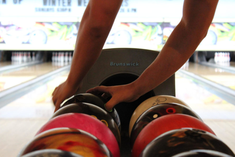 A Brantley bowler reaches for the ball to start his turn on Monday, August 27 at Oviedo Lanes.  The bowlers tended to use the same balls for their turns.