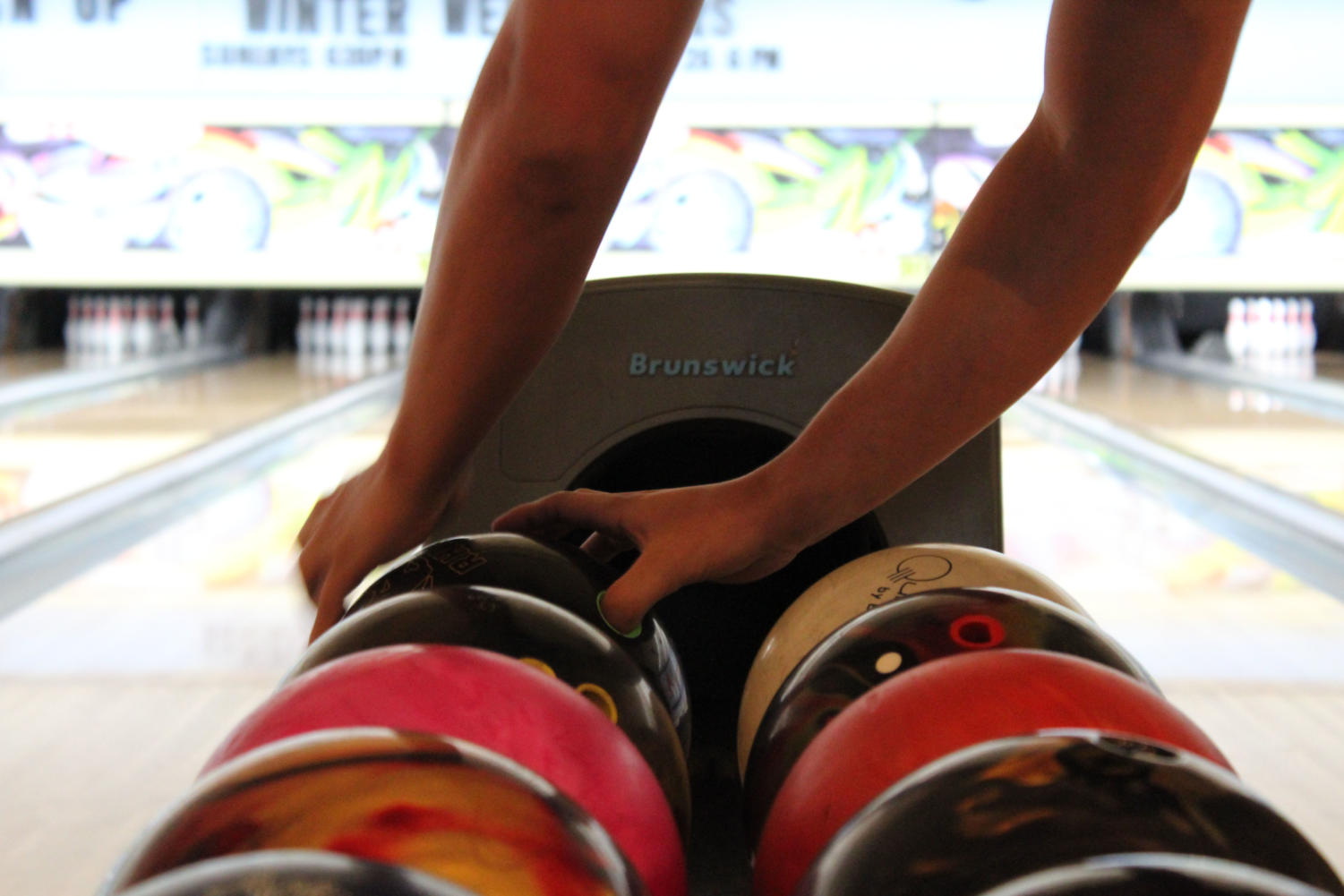 A+Brantley+bowler+reaches+for+the+ball+to+start+his+turn+on+Monday%2C+August+27+at+Oviedo+Lanes.++The+bowlers+tended+to+use+the+same+balls+for+their+turns.
