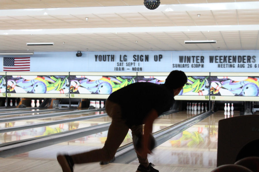 Senior Austin Ray steps before he releases the ball at Oviedo Lanes on Monday, August 27. Most of the boys on the team use both hands to roll the ball and make it curve.