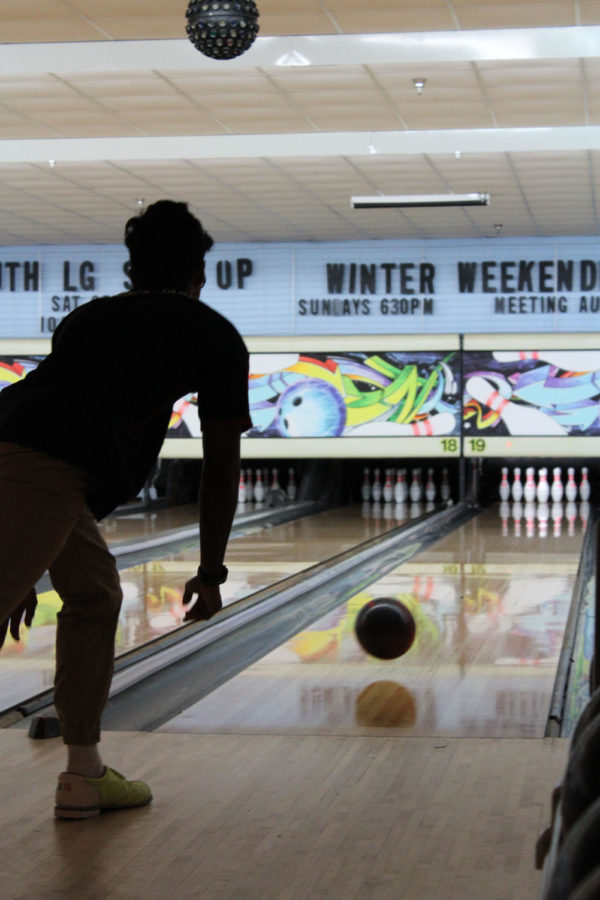 Senior Josh Singh rolls the bowling ball down the lane during a tournament at Oviedo Lanes on Monday, August 27. Before starting their turns, the bowlers used the vent at the back of the ball return to make sure their hands were dry so the ball would release smoothly.