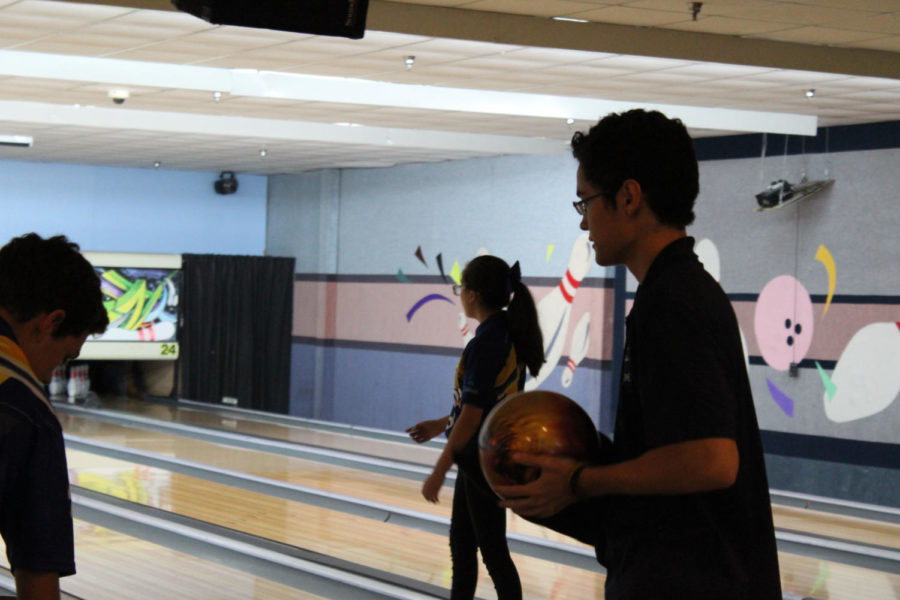 Senior Austin Ray prepares to begin his turn during the bowling tournament  at Oviedo Lanes on Monday, August 27. The boys used a piece of cloth to polish the balls before rolling.