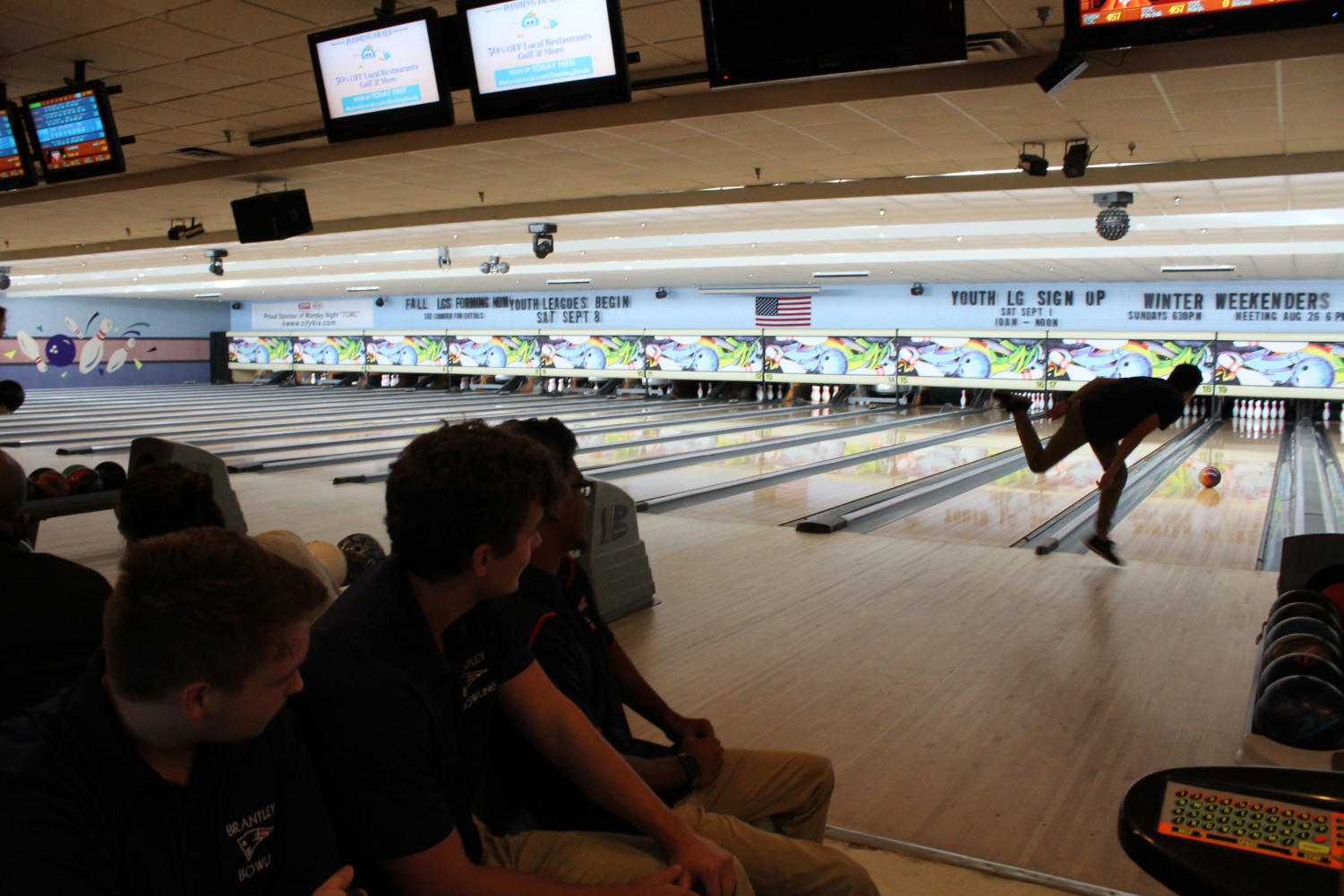 The+team+watches+one+of+their+teammates+take+his+turn+bowling+on+Monday%2C+August+27+at+Oviedo+Lanes.+After+a+good+turn%2C+the+players+would+exchange+high+fives+and+handshakes.