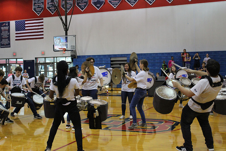 In+the+main+gym%2C+the+Lake+Brantley+Drumline+performs+a+selection+of+their+cadences+on+Feb.+2+in+between+the+plays+of+the+game.+%E2%80%9CDrumline+got+to+have+another+one+of+their+pep+rally-like+moments+playing+a+drum+circle+in+the+center+of+the+court%2C%E2%80%9D+said+junior+and+snare-drum+player+Ben+Evelev.%E2%80%9DIt+was+an+awesome+time+and+I+believe+the+whole+event+was+worthwhile.%E2%80%9D