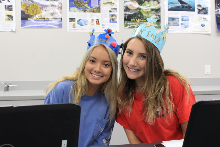Carlee Crocker and Sarah Vratanina pose with their senior crowns on Friday, August 16 in Lauren D'Ambrosio's classroom 5-018. Crocker's crown was decorated with sharks, her favorite animal, and Vratanina's with seashells.