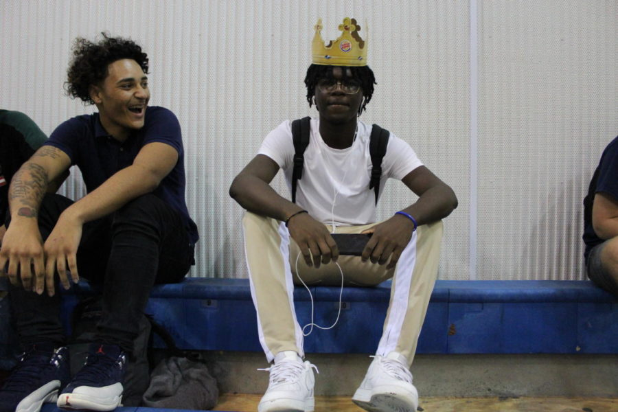 Alexander Floyd poses with his Burger King crown while Patrick Jackson laughs right before the start of the pep rally in the main gym on Friday, August 23. While many chose to decorate their crowns, Alex went for the simple look.