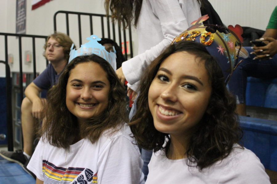 """Allison Rosenberg and Natalia Negron wear their themed senior crowns to the pep rally in the main gym on Friday, August 23. """"I chose Stranger Things because it is one of my favorite TV shows,"""" says Natalia Negron. """"It took me two days to make, and the show itself is a representation of the red communist scare and the experiments they did on people during that time period."""""""