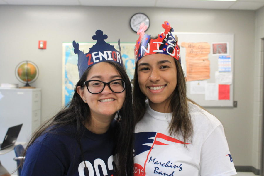 Seniors Samarys Morales-Melendez and Anayansi Santiago smile while wearing their senior crowns on Friday, August 16 in William Geeslin's classroom 7-226. That Friday was the first official day for seniors to wear their crowns, but the tradition continues every Friday.