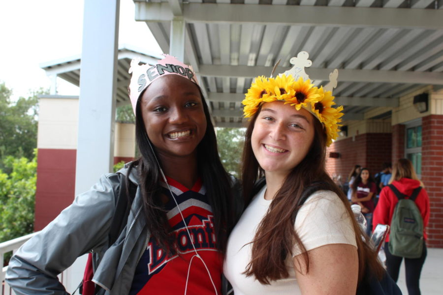 Jordan Lowe and Jaiden Doling show off their colorful crowns outside of building 8 on Friday, August 23. Even participants in that day's pep rally, including cheerleaders, band members, and the senior MCs, were encouraged to wear their crowns.