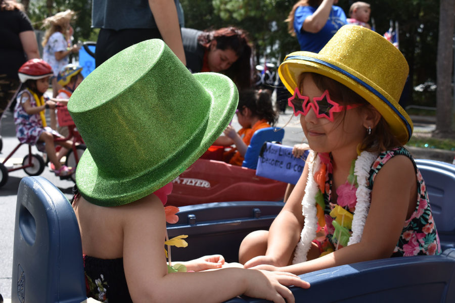 Two Little Patriots ride in a blue wagon in the homecoming parade on Thursday, October 10. The theme for homecoming was Escape to Paradise so participants dressed up in leis and sunglasses.