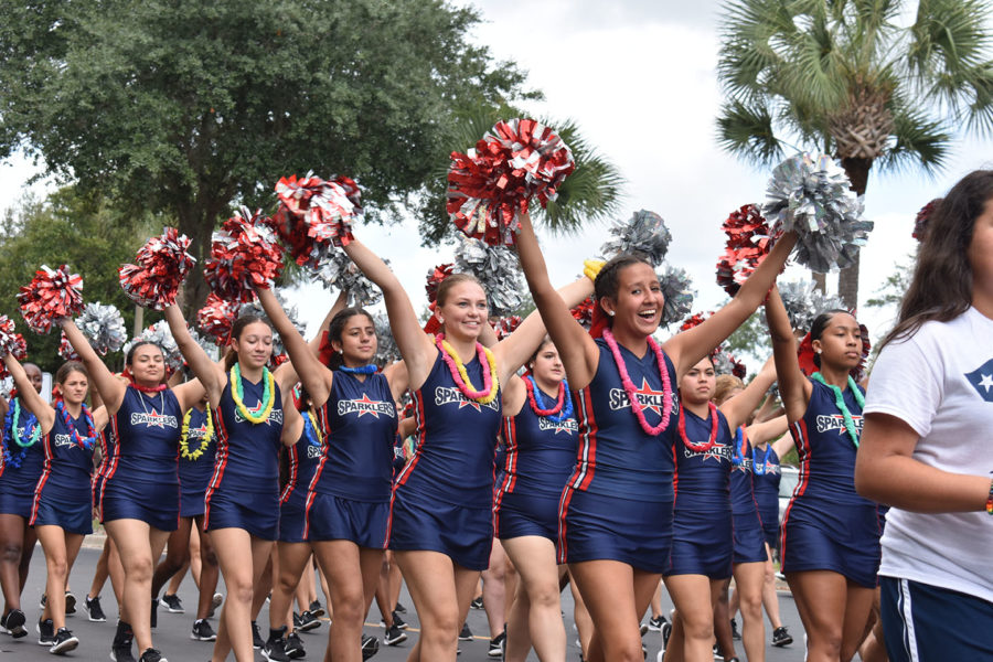 Sparklers dance team walks in the homecoming parade on Thursday, October 10. The Sparklers also performed at the homecoming pep rally the following day.
