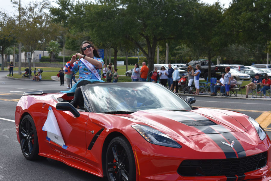 Teacher of the Year, Katie Turkelson rides in a Corvette on Thursday, October 10 in the homecoming parade. Turkelson won teacher of the year at the school level and will find out about the district, county and state levels later this year.