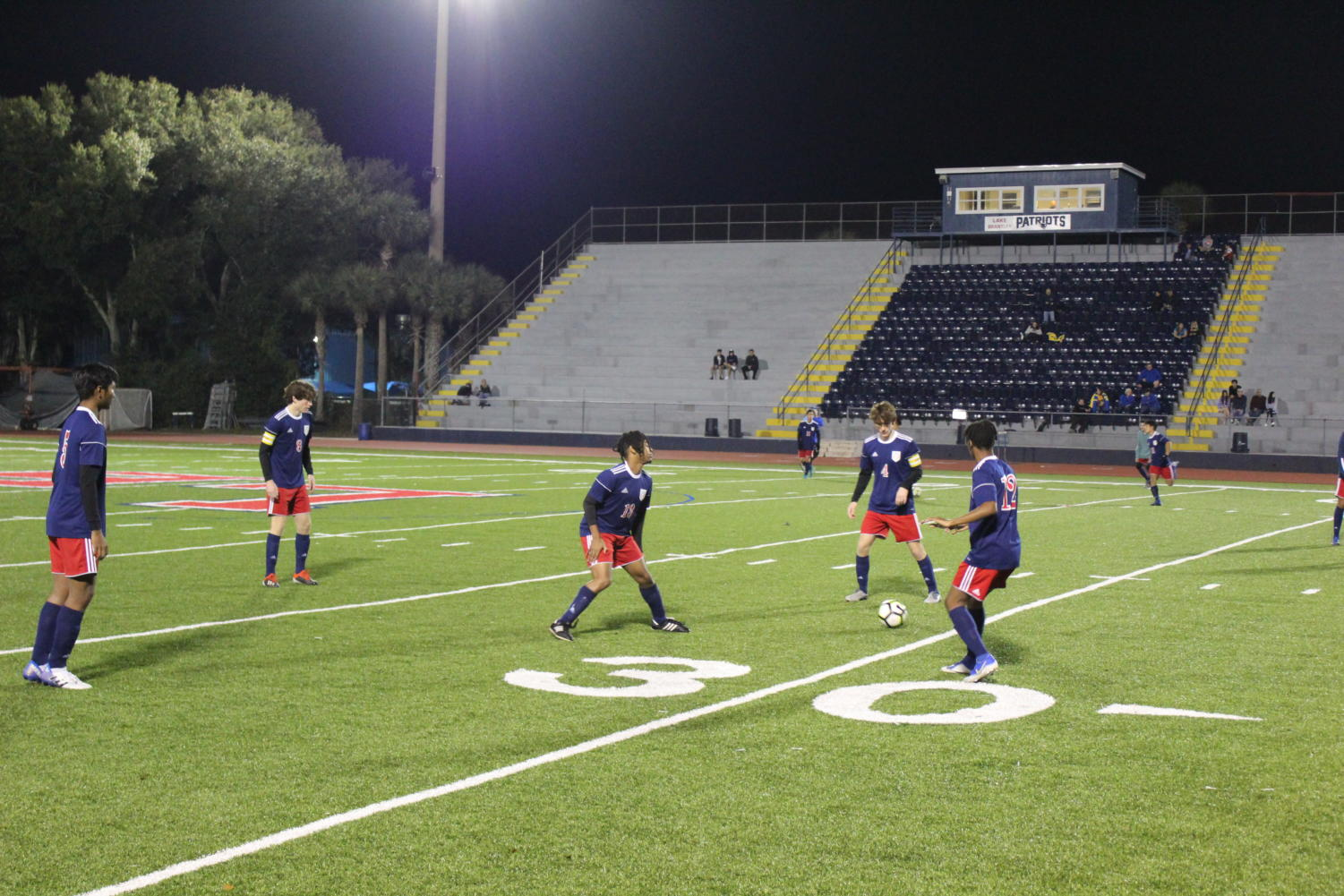 The varsity boys' soccer team runs through a passing drill before their game against Lyman High School on Wednesday, Nov. 20 on Tom Storey Field. These drills give the players a chance to warm up their legs, develop chemistry with their teammates, and put  themselves in the right mindset.