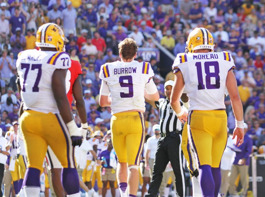 LSU+Tigers+quarterback+Joe+Burrow+%239%2C+LSU+Tigers+offensive+tackle+Saahdiq+Charles+%2877%29%2C+and+LSU+Tigers+tight+end+Foster+Moreau+%2818%29%2C+Georgia+Bulldogs+vs+LSU+Tigers%2C+Football%2C+Tiger+Stadium%2C+October+13%2C+2018%2C+Baton+Rouge%2C+Louisiana%2C+Tammy+Anthony+Baker%2C+Photographer