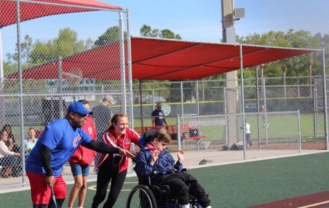 """Assisting kids with special needs in America's favorite pastime is a way that Reagan Sienkiewicz, a junior on the Varsity Softball team, and many of her teammates give back to the community. The Bambino Buddy Ball league provides the kids with an outlet to meet new people and teaches important social skills. """"The most surprising aspect I have experienced is that I can have a big impact on the kids I help out,"""" Sienkiewicz said. """"It might not seem like much, but I know it means the world to the kids and their parents."""""""