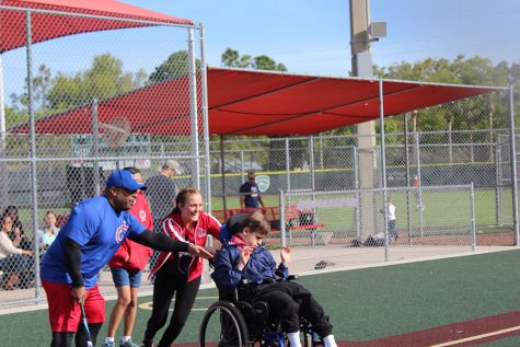 "Assisting kids with special needs in America's favorite pastime is a way that Reagan Sienkiewicz, a junior on the Varsity Softball team, and many of her teammates give back to the community. The Bambino Buddy Ball league provides the kids with an outlet to meet new people and teaches important social skills. ""The most surprising aspect I have experienced is that I can have a big impact on the kids I help out,"" Sienkiewicz said. ""It might not seem like much, but I know it means the world to the kids and their parents."""