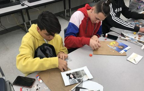"""On Feb. 27, students Andres Garcia (left) and Luis Rivera (right), work on gluing their magazine pieces down after sketching out their photo.  """"What I like about this project is how we build the picture bottom to top, piece by piece,"""" Garcia said."""
