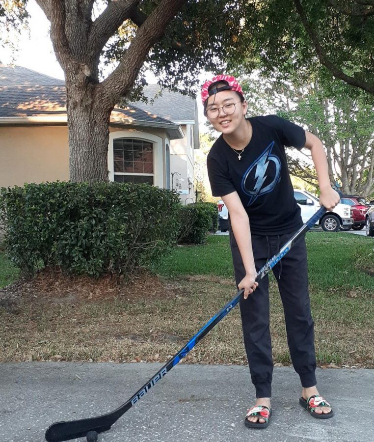 Since ice rinks are closed for quarantine, Sophomore Julia Moon practices stick-handling outside her front yard with an old hockey stick and taped golf ball.