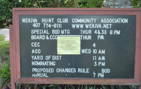A public events notice board for the Wekiva Hunt Club Community Association notifies residents that public areas are closed until further notice on May 13.