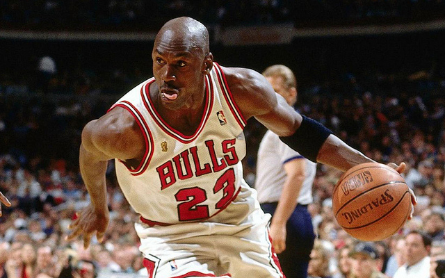 "Michael Jordan dribbles the basketball during his playing days. ""The Last Dance"" has given younger fans a chance to see Jordan in action."