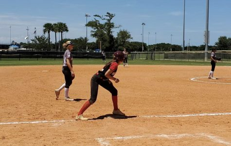 """Junior Ella Christopher gets ready to score from third base during a showcase tournament in Myrtle Beach, South Carolina this past summer. Travel softball was at a standstill to slow the spread of COVID-19. Tournament organizations implemented new regulations to get the athletes playing again, as summer is a crucial time for college recruitment. """"I went to Myrtle Beach in South Carolina because I'm trying to get recruited for college,"""" Christopher said."""