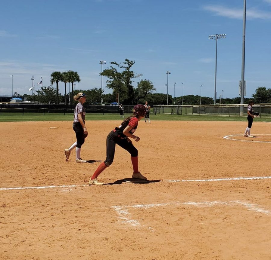 "Junior Ella Christopher gets ready to score from third base during a showcase tournament in Myrtle Beach, South Carolina this past summer. Travel softball was at a standstill to slow the spread of COVID-19. Tournament organizations implemented new regulations to get the athletes playing again, as summer is a crucial time for college recruitment. ""I went to Myrtle Beach in South Carolina because I'm trying to get recruited for college,"" Christopher said."
