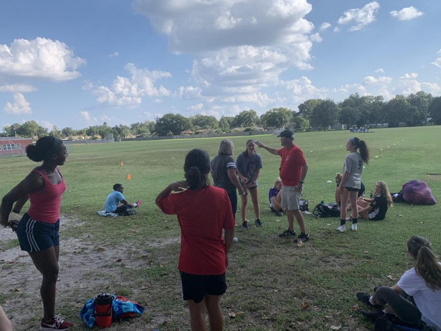 Before conditioning, girls gather and sit in the shade before working out in the rigorous heat. Over the course of the 2 weeks, players fought through temperatures ranging from the high 80s to low 90s.