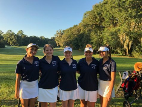 On Monday, Oct. 19, members of the girls' golf team pose in the fairway section of the course in Gainesville, FL. The players had a great season and made it all the way to regional finals. The girls remain hopeful that they will have an even better season next year.