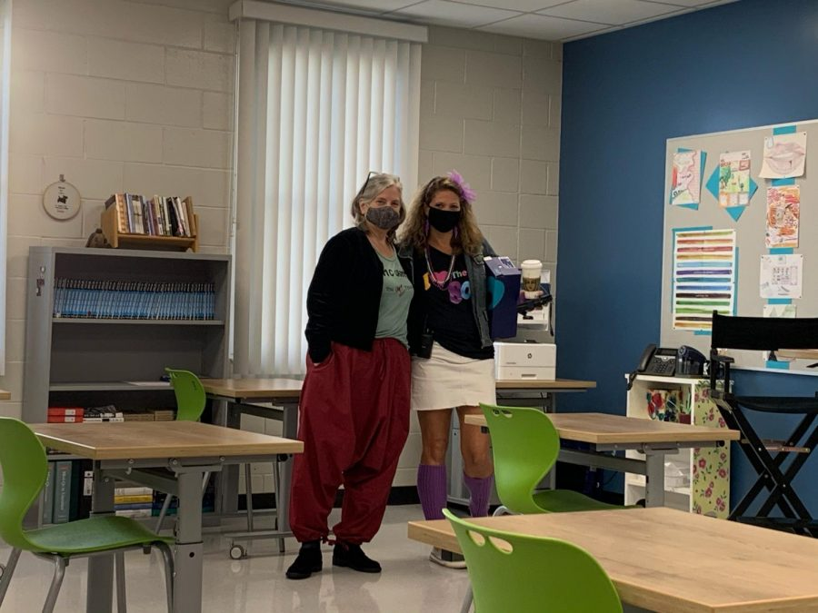 AP Research teacher Tracy Fitzgerald and Assistant Principal Colleen Windt wear the fashion trends from the late '80s and '90s for Twisted Time Travel spirit day. Twisted Time Travel is one of the five spirit days of Homecoming week, the others being Neon Attack, Cowboys v.s Aliens, Spaced Out, and Patriot Pride.