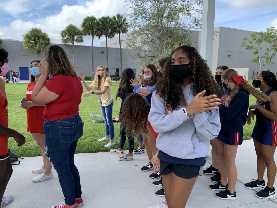 "Dancing to the drumline's performance during the Lunch Pep Rally on Friday, Nov. 6, sophomore Angelina Joseph shows her school spirit for this year's modified homecoming activities. Although COVID-19 restrictions caused homecoming week to be altered by moving the pep rally outside during lunch, changing the homecoming dance and Powder Puff game to a later date, and limiting the number of people that attended the football game, leadership still found ways to allow students to have a week to celebrate homecoming. ""Even though I didn't like it [pep rally] as much, I'm still glad that we were able to show school spirit in at least one way,"" Joseph said."