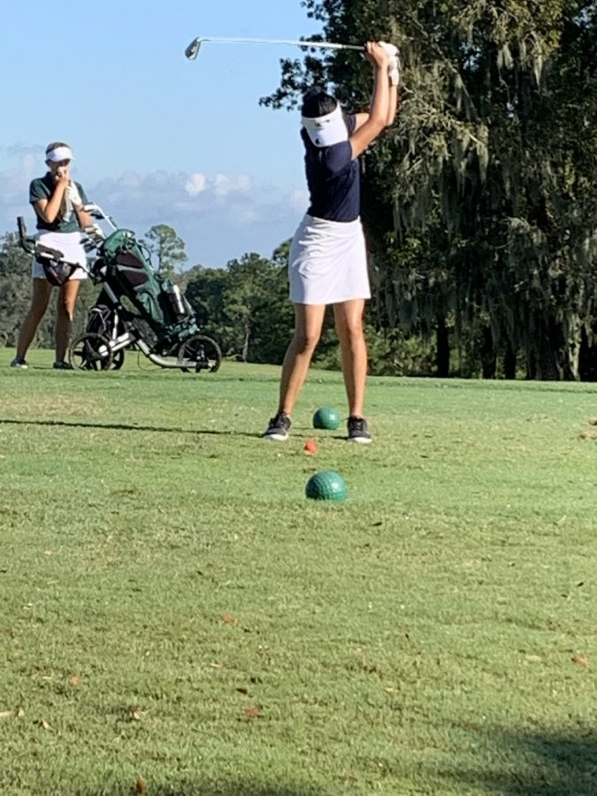 Sophomore Sienna Banangada lines up her shot at the district meet at Ocala on Oct. 12. This meet qualified them for the regional's meet on Oct. 19. This was an exciting moment caught on camera by Coach Peggy Leis.