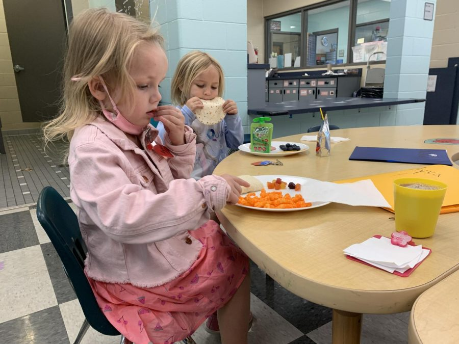 """The preschoolers dive into their meals after they return from playing outside. Their meals are all prepared and brought in by their parents, but they receive a list of recommended healthy foods from Early Childhood Education teacher Andrea Lesko. """"We give them recommendations of healthy items that we would like them to have, which is why every child's lunch is different,"""" Lesko said. """"Their parents decide, at the beginning of the school year, what type of drink they would like their child to have and we get those from the cafeteria every morning, so they all have different things, whether that is chocolate milk, water, white milk, or juice."""""""