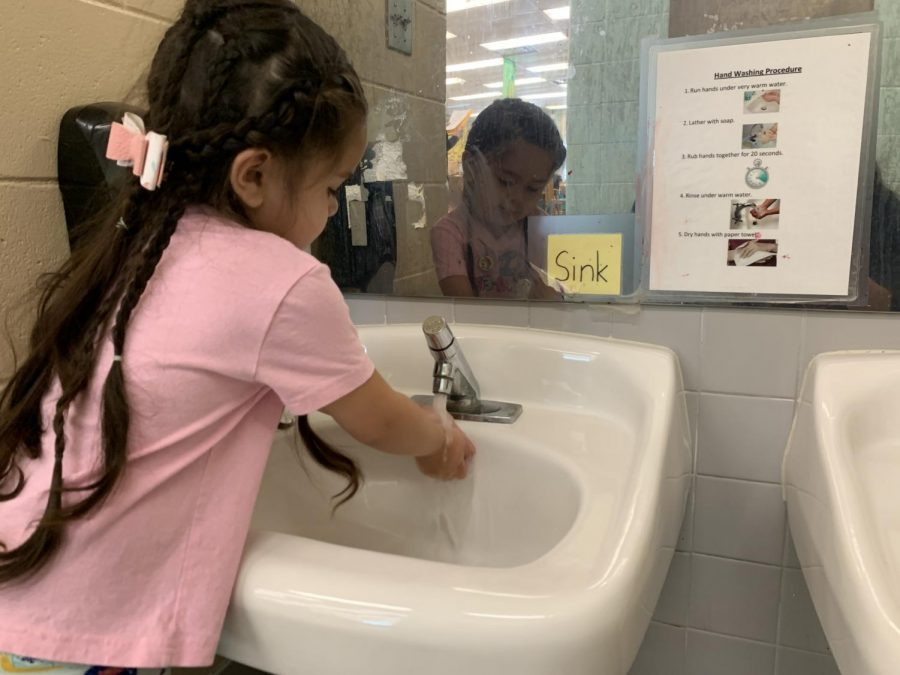 """Before sitting down to eat lunch, the preschoolers wash their hands. The preschoolers have learned to form habits early of self-hygiene early on. """"We bring the kids in from outside and wash their hands,"""" sophomore Mayson Cooney said. """"Its important for the kids to wash their hands because when theyre outside, there are a lot of germs. They touch a lot of stuff with their hands, so we have the children wash wash their so that they don't get sick."""""""