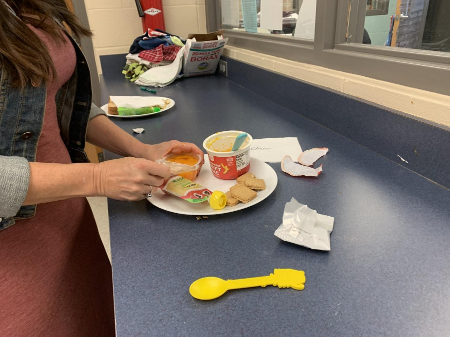 "Before the preschoolers come inside, Early Childhood Education teacher Andrea Lesko prepares lunches, while the high school student-teachers play with the children outside. In years prior, Lesko has an equivalent ratio of preschoolers to high schoolers, so the smaller number has caused a multitude of changes in the way that the Little Patriots classroom runs. ""In a typical year, not a COVID year, we would have a lot more high schoolers in this class,"" Lesko said. ""They would usually be the ones to get the lunches plated and cut up and heated up, but because of this year and the way that the class schedules work, I only have five high school students in this class with 14 preschoolers."""
