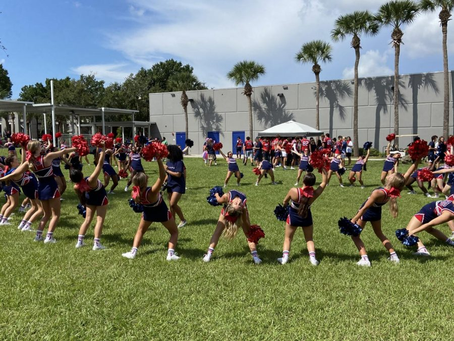 Cheerleaders bend backwards during the pep rally on September 10 before the game against Lake Mary.