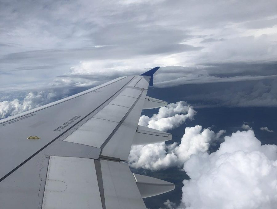 On board an Allegiant airline flight to Appleton, Wis., journalism teacher Katie Turkelson watches the clouds float by from her window seat. Turkelson considers herself a window Sleeper.