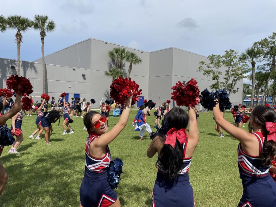 Junior Kylie Johnson and fellow cheerleaders show off their school spirit during the lunch pep rally on September 10th.