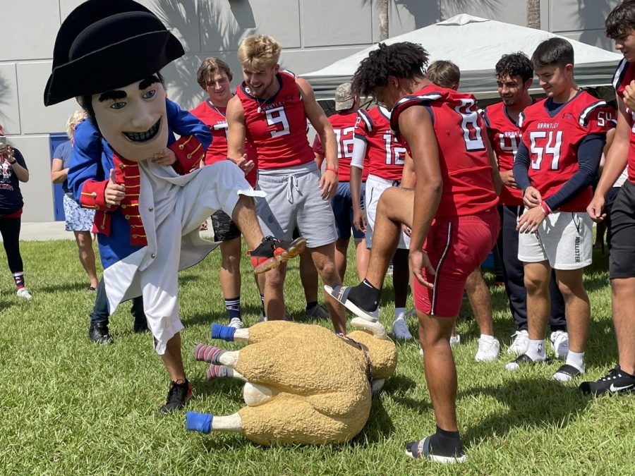 Patriot Pete and the football team attack the ram in hopes to secure a win for this year.